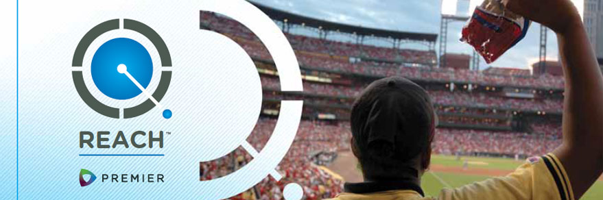 Image showing the REACH™ logo superimposed over a vendor holding up food at a sports stadium.
